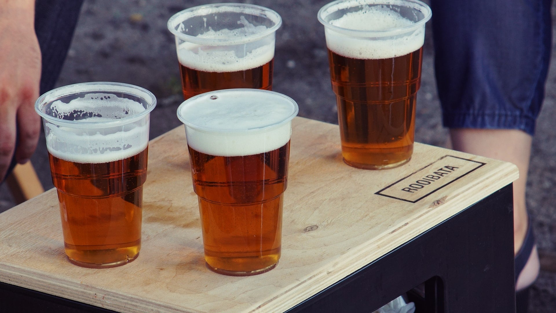Four cups of beer on a table