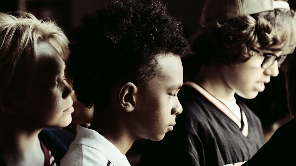Photo of a group of sad children looking at something