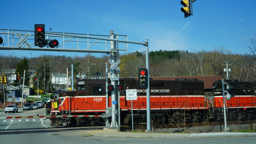 Photo of a train passing by a rail lines located in Worcester Massachusetts