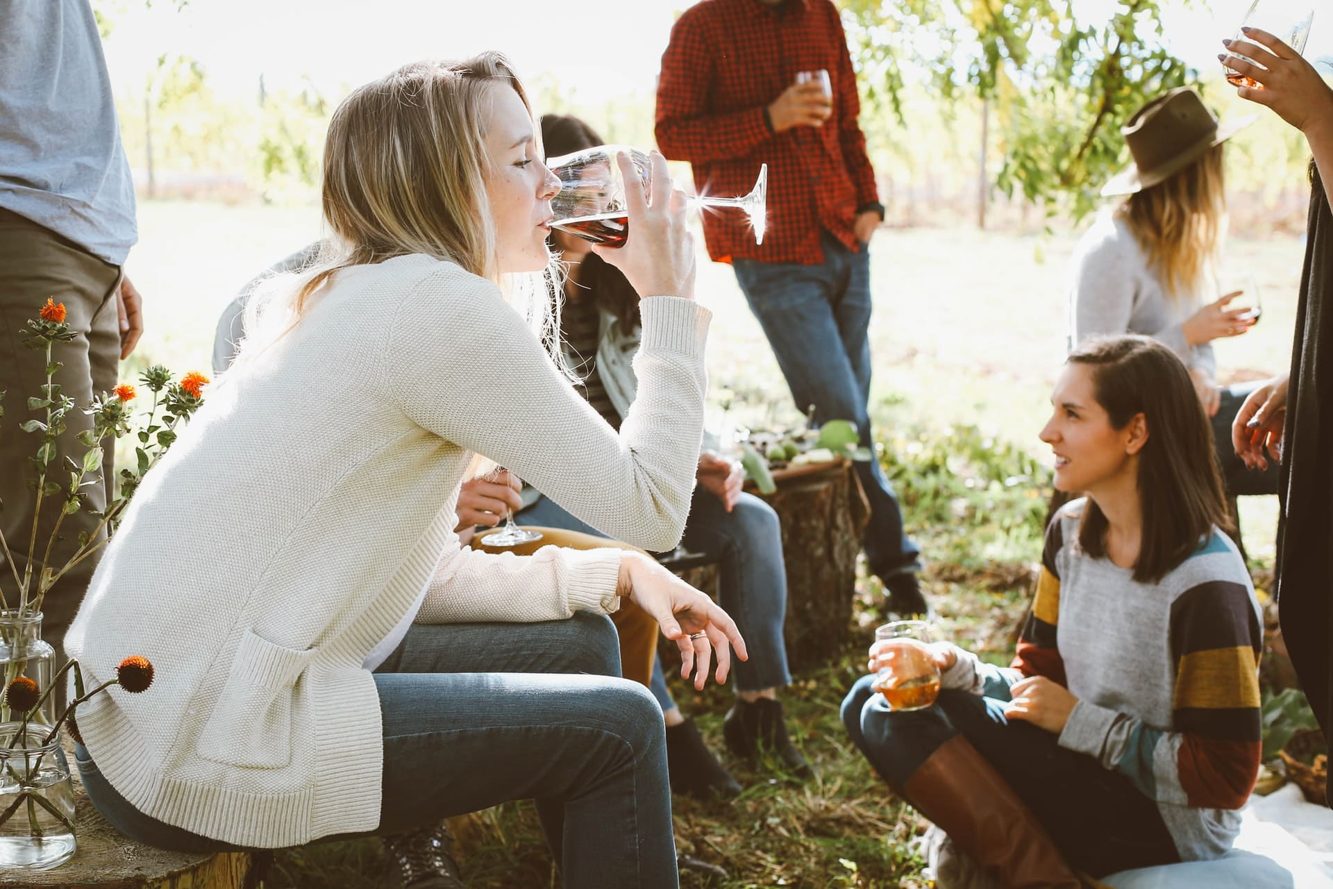 young people drinking alcohol outdoors